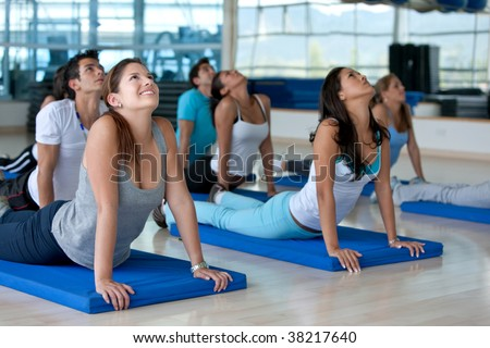 people ath the gym in a stretching class