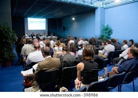 People attending a conference - stock photo