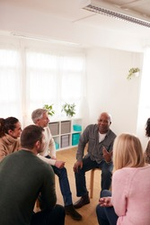 People Attending Support Group Meeting For Mental Health Or Dependency Issues In Community Space