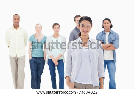 People behind a woman smiling against white background - stock photo