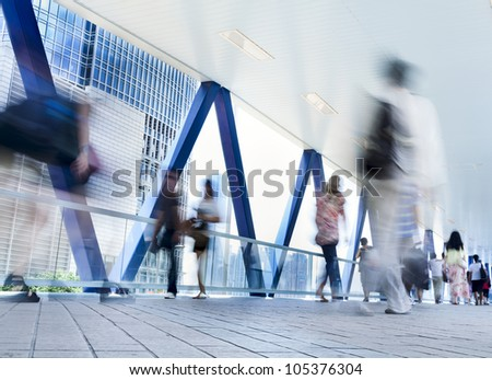 People blurred in motion on the street walking