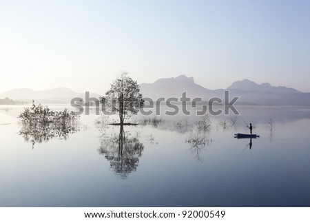 People boating in the reservoir of the dam, Mae Moh in Thailand.