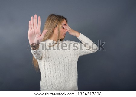 Free photos Woman with hands covering eyes against white background