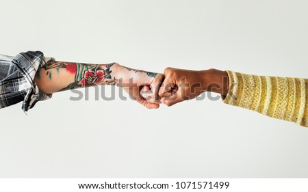 People bumping their fists together