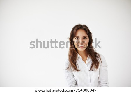 People, business, success and life goals concept. Successful beautiful young Hispanic female entrepreneur in formal shirt standing against white studio wall backgrounf with copy space for your text #714000049