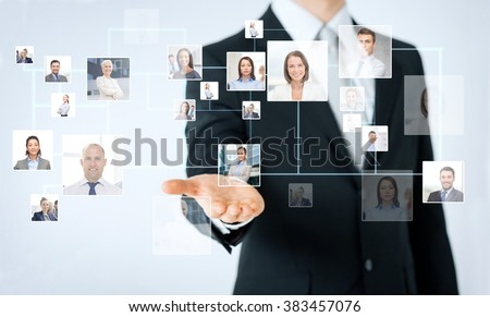 people, business, technology, headhunting and cooperation concept - close up of man hand showing business contacts icons projection