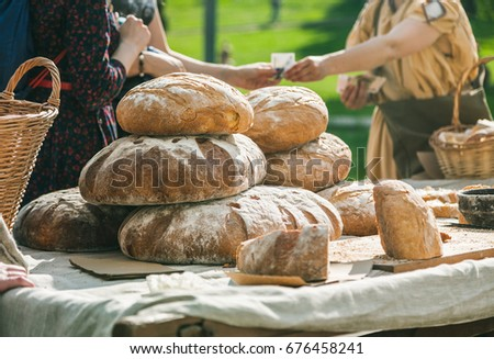 people buying bread at outdoors ...
