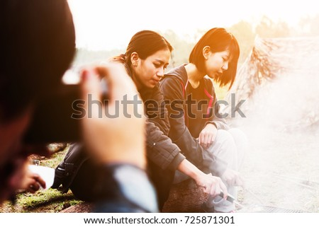 people camping at national park in holiday ; doing breakfast and activity at sunrise ; relaxing in nature   #725871301