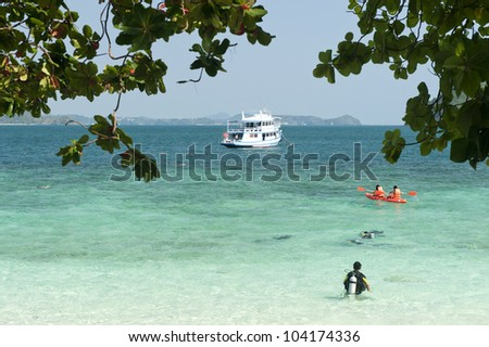 people canoeing and dive training on phuket beach, Thailand.