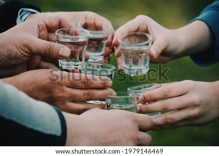 people celebrating and toasting with shots of alcohol vodka outdoors Zdjęcia stock ©