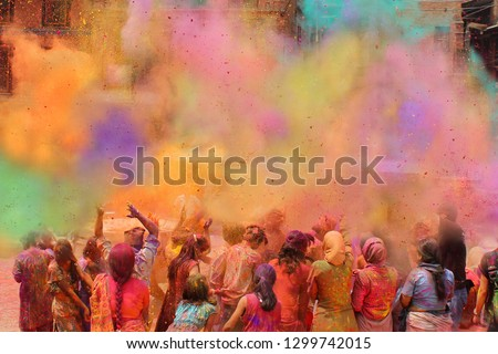 People celebrating the Holi festival of colors in Nepal or India #1299742015