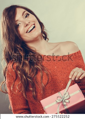 People celebrating xmas love and happiness concept - beauty girl opening present pink gift box, smiling positive face expression