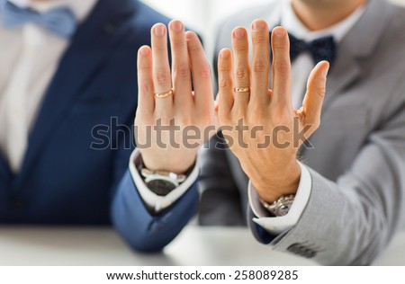 people, celebration, homosexuality, same-sex marriage and love concept - close up of male gay couple with wedding rings on putting hand on shoulder - Shutterstock ID 258089285