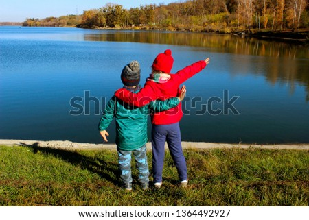 People, Childhood, Travel And Family Concept. Boy And Girl  Hugging Outdoors. Happy Children  Enjoying  Outdoor.  Brother And Sister Walking.