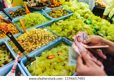 People choose to buy a lot of vegetarian food in vegetarian Festival. Yaowarat or bangkok china town , Thailand #1196657485