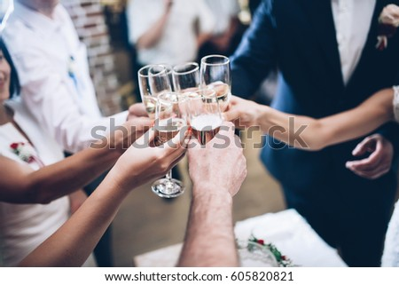 Shutterstock People clang glasses staying at dinner in sparkling lights