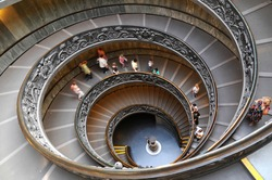 People climbing down the stairs of the Vatican Museums in Vatican, Rome, Italy