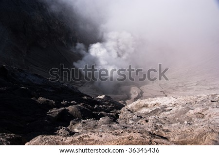 People climbing famous volcano mountain bromo crater
