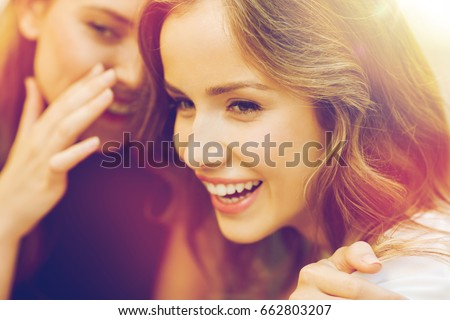 people, communication and friendship concept - smiling young women gossiping and whispering secrets