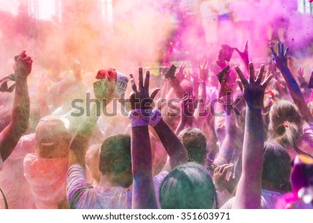 people covered with colored powder. Color Run Thailand