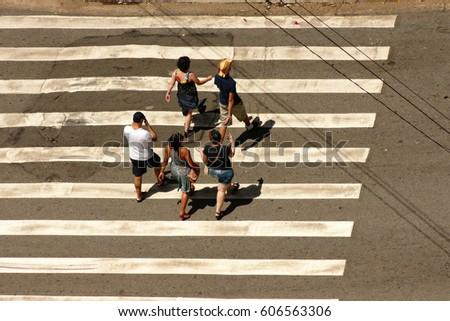 People crossing a road #606563306