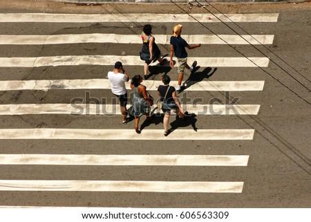 People crossing a road #606563309