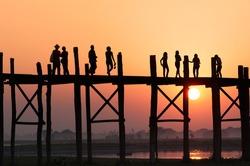 People crossing  bridge