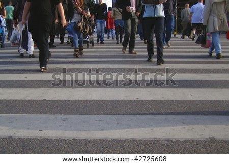 people crossing the street in London
