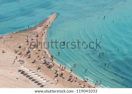 People crowd on the beach, top view, Spain