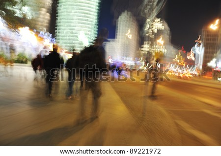 People crowd walking in the city at night (blurred scene)