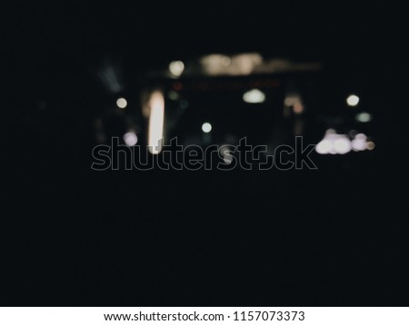 People dance at the music festival at night. Photo of crowd with raised up hands nightclub, audience applauding to musician band, night entertainment, music festival, happy youth. blurred photo #1157073373