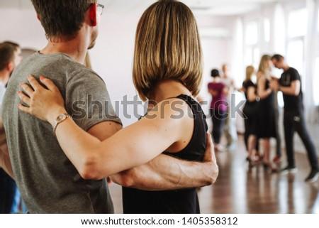 people dancing a kizomba dance on the dance floor #1405358312