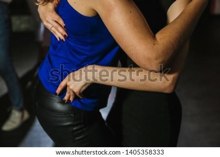 people dancing a kizomba dance on the dance floor #1405358333