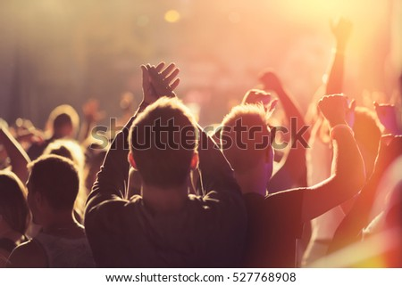 People dancing and cheering at music festival #527768908