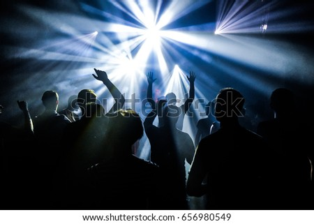 people dancing in party club with neon lights