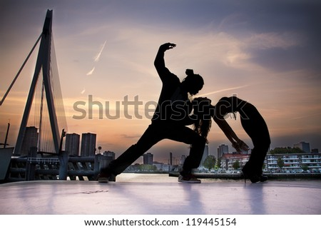 People dancing with Rotterdam on the background