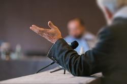people debating at seminar presentation