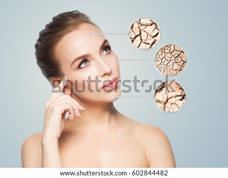 people, dehydration, skincare and beauty concept - face of beautiful woman with damaged dry skin samples #602844482