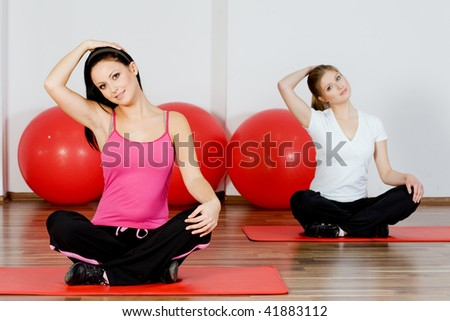 people doing yoga classes at the gym