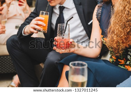 People drinking soft drinks at a social event #1327011245