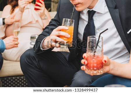 People drinking soft drinks at a social event #1328499437