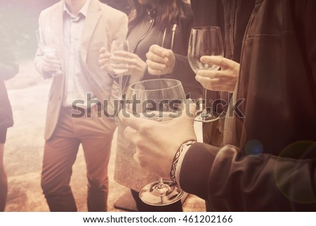 people drinking wine vintage effect, a group of friends is socializing and having a fun
