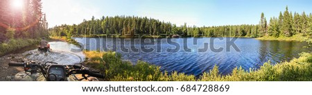 People driving ATV quads through water. Lake in Ontario, Canada. Stock photo ©