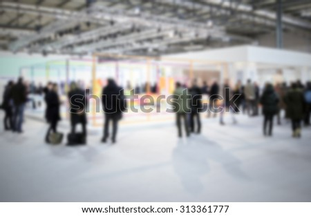 People during an event, intentionally blurred post production background.
