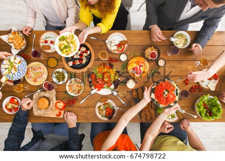 People eat healthy meals at served table dinner party, table top view #674798722