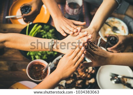 people eating food together with fun and happy in holiday party.celebration meeting a group of friends in free time. #1034383063