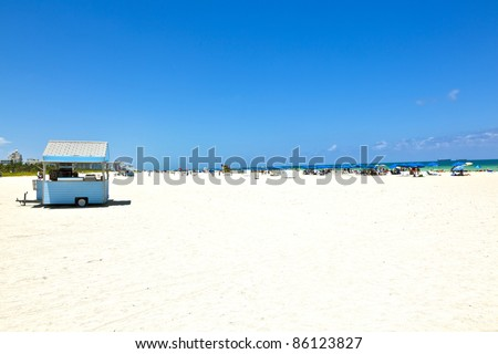 People enjoy the beach and swimming in South Beach - stock photo