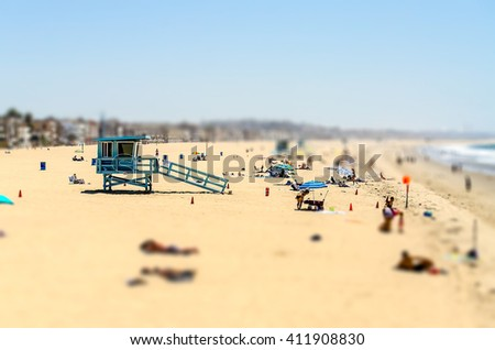 People enjoying a sunny day in Venice Beach, California, USA. Tilt-shift effect applied - stock photo