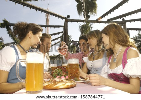 Photo of People enjoying beer at festival in Munich