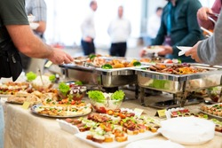 People enjoying buffet food meal.
